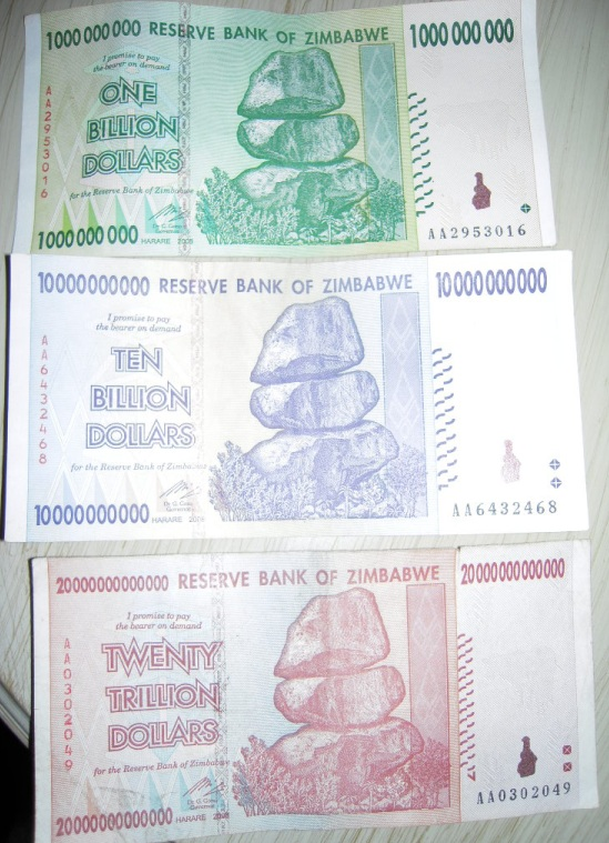 Images of 3 Zimbabwean dollar bills: 1 billion dollars, 10 billion dollars, 20 trillion dollars